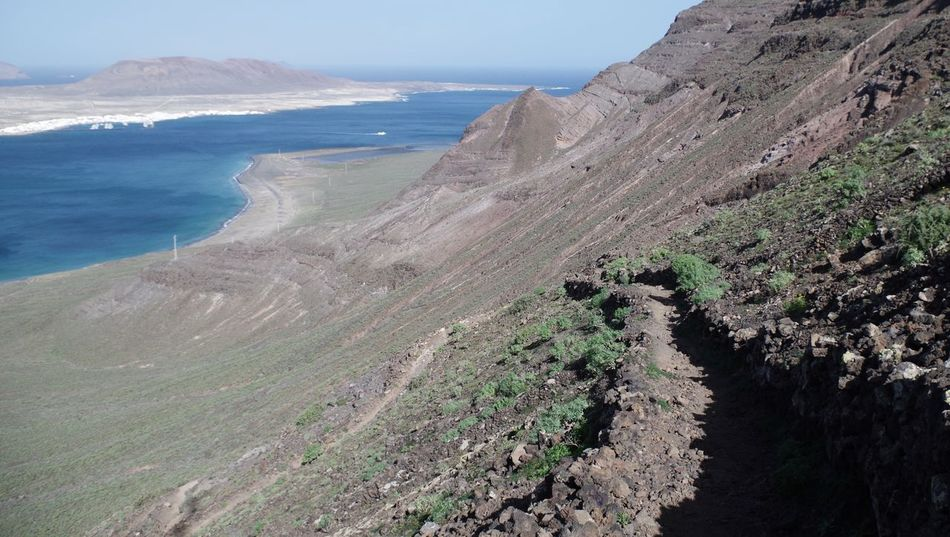going down to playa del risco. Beach Beauty In Nature Canary Islands Cliff Coastline Curvature Day Downhill High Angle View La Graciosa Landscape Lanzarote Mirador Del Río Nature No People Ocean Outdoors Path Scenics Sea Valley Water Wilderness Winding Path Winding Road