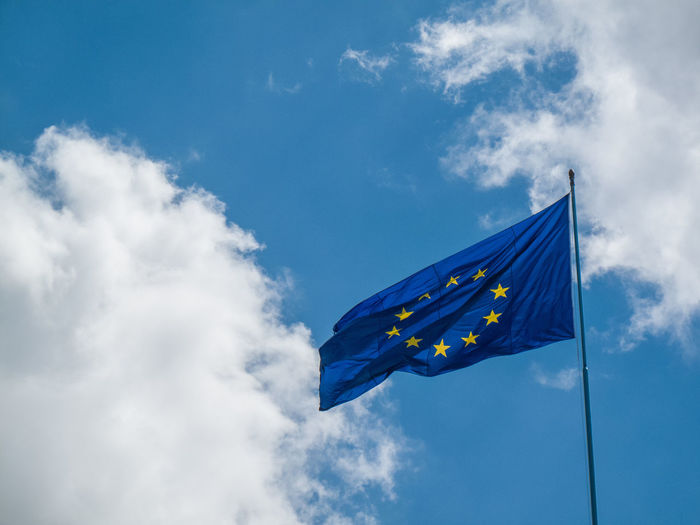 Low Angle View Of The European Flag Against Blue Sky