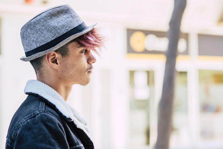 Portrait of man wearing hat looking away