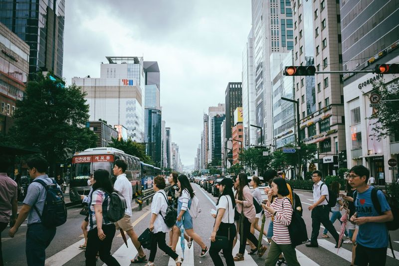 Heading somewhere 🚶🏻🚶🏻‍♀️ City Architecture Large Group Of People Skyscraper City Life Real People Walking Street City Street Outdoors Modern Crowd Travel Destinations Lifestyles Seoul Gangnam Gangnam Style Korea Asian Culture Crossing Crosswalk Crossroads Crossing The Street The Week On EyeEm Gangnam Street