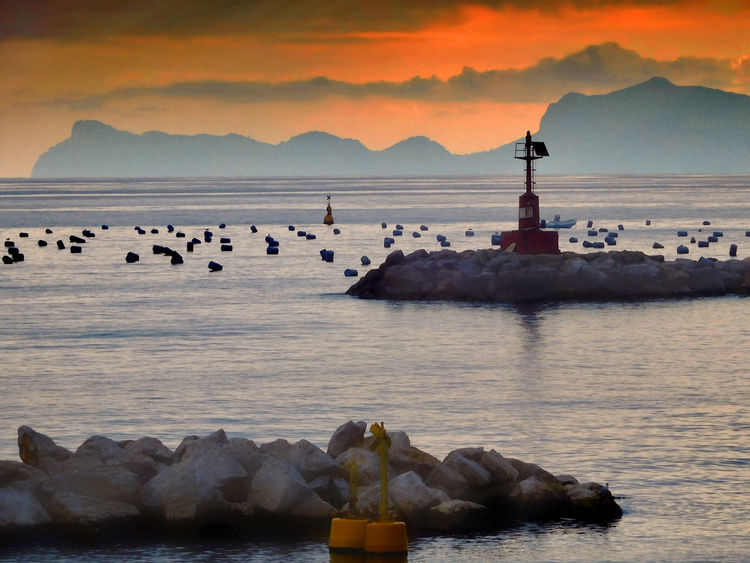 Pier Beauty In Nature Buoy On The Water Dusk Golden Hour Lighthouse Mountain Nature No People Outdoors Scenics Sea Sunset Water An Eye For Travel