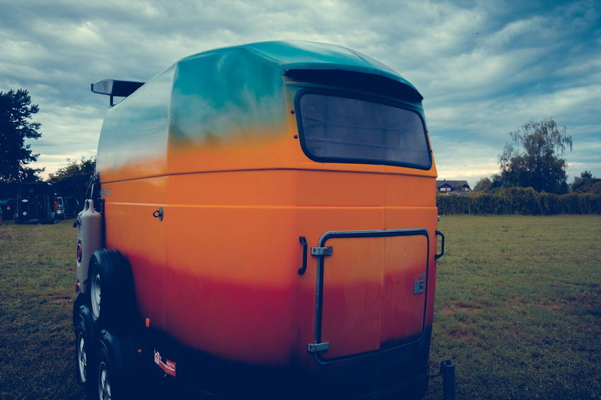 Horse Trailer Cloud - Sky Day Dramatic Sky Field Horse Horse Trailer Journey Landscape Non-urban Scene Orange Color Outdoors Remote Scenics Sky Trailer Tranquil Scene Tranquility Transportation Travel Tree Vibrant Color Yellow