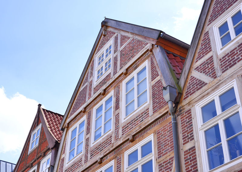 Old house facades in Buxtehude, Germany. Architecture Blue Building Building Exterior Built Structure Buxtehude City Clear Sky Day Flag House House Facades Low Angle View Nature No People Old Buildings Old Houses Outdoors Patriotism Pattern Residential District Row House Sky Sunlight Window