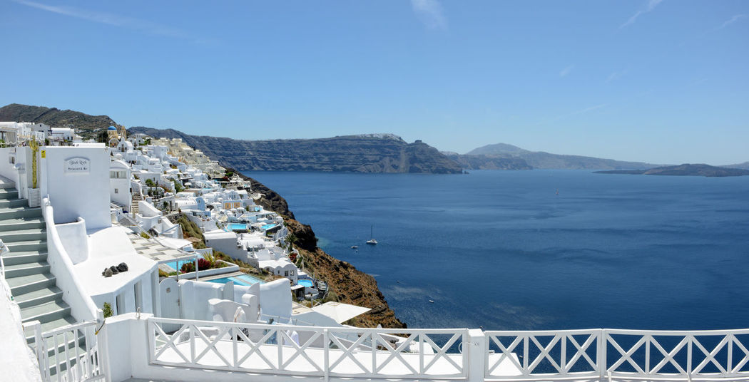 Ia, Santorini / GREECE May 15 2017: Cityscape of Ia, town at Santorini Isle (Greece) with its typical white houses. View into Caldera of Volcano. made of 6 images Building Exterior Built Structure Clear Sky High Angle View Mountain Mountain Range Nature No People Outdoors Railing Santorini Santorini Greece Santorini Island Santorini View Santorini, Greece Sea Tranquil Scene Tranquility Water