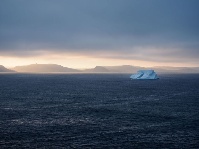 Iceberg on Atlantic ocean near St. John's, Newfoundland, Canada Iceberg Iceberg - Ice Formation Newfoundland Sunny Day St. John's Scenics - Nature Sea Water Beauty In Nature Nature No People Outdoors Sky Tranquil Scene Tranquility Cloud - Sky Remote Ice Floating On Water