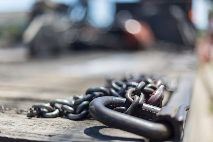 Heavy metal chains Chain Close-up Construction Day Equipment Focus On Foreground Heavy Heavy Chains Heavy Metal Equipment Labor Metal Metal Chains Metal Platform Morning No People Outdoors Rusted Shallow Depth Of Field Strong Sunlight Sunny Work