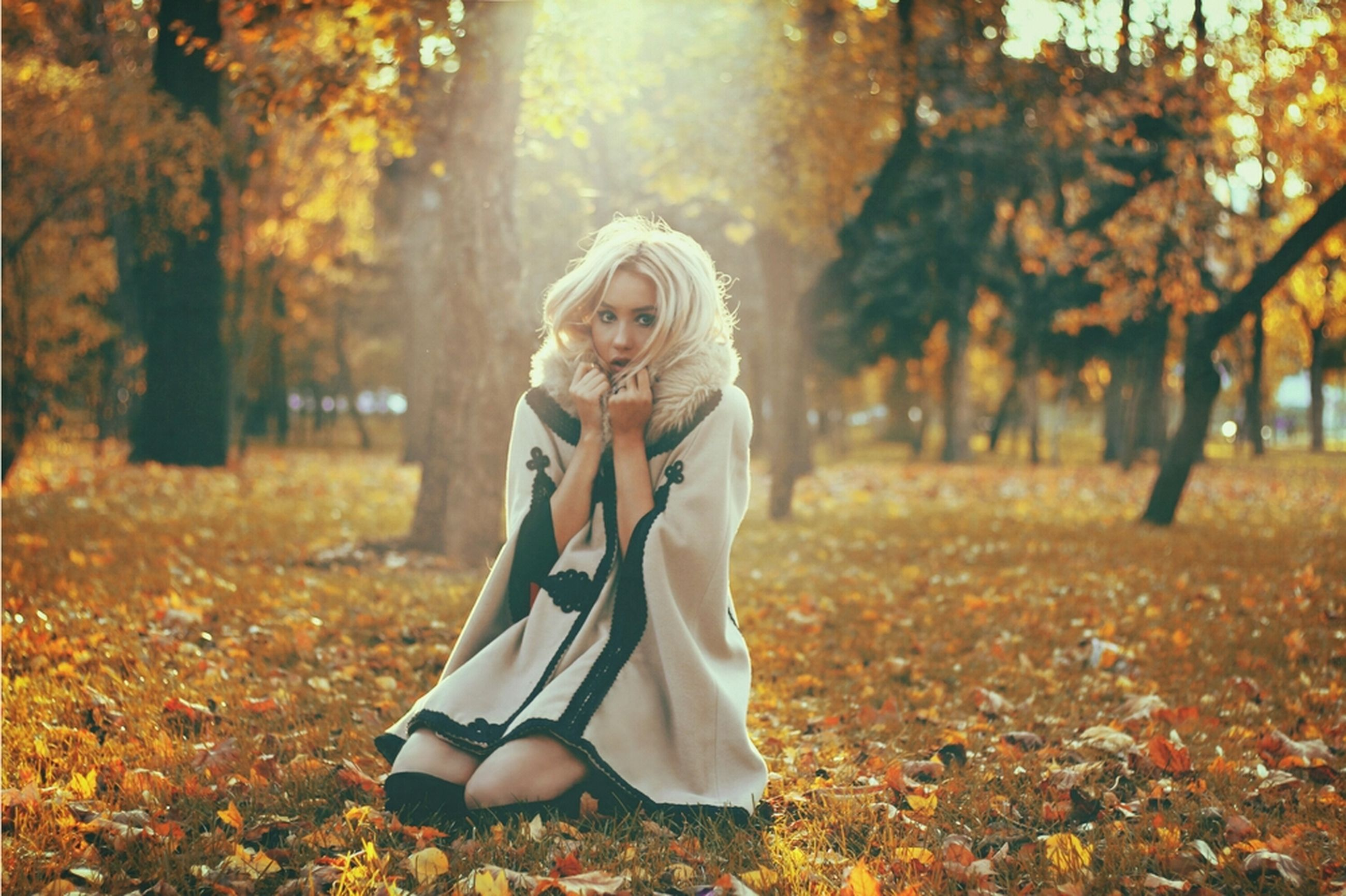 person, young adult, lifestyles, casual clothing, tree, leisure activity, autumn, young women, standing, park - man made space, front view, looking at camera, portrait, smiling, focus on foreground, season, field, three quarter length