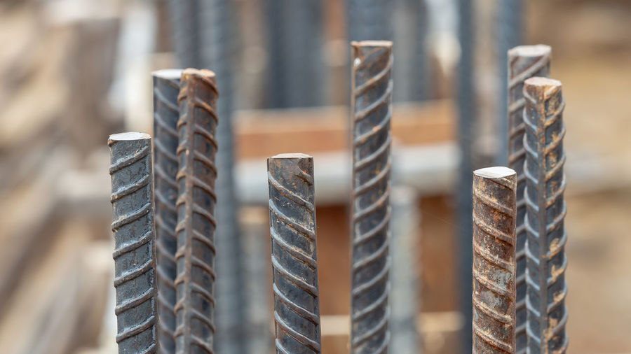 Construction Arrangement Business Close-up Day Focus On Foreground In A Row Industry Large Group Of Objects Metal No People Outdoors Pattern Repetition Selective Focus Silver Colored Spiral Stack Steel Still Life Tire Wheel
