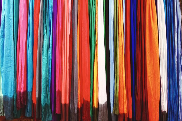 Full frame shot of colorful clothes hanging at market