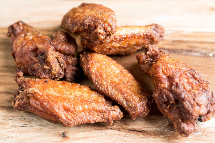 Close-up of roasted chicken wings on cutting board