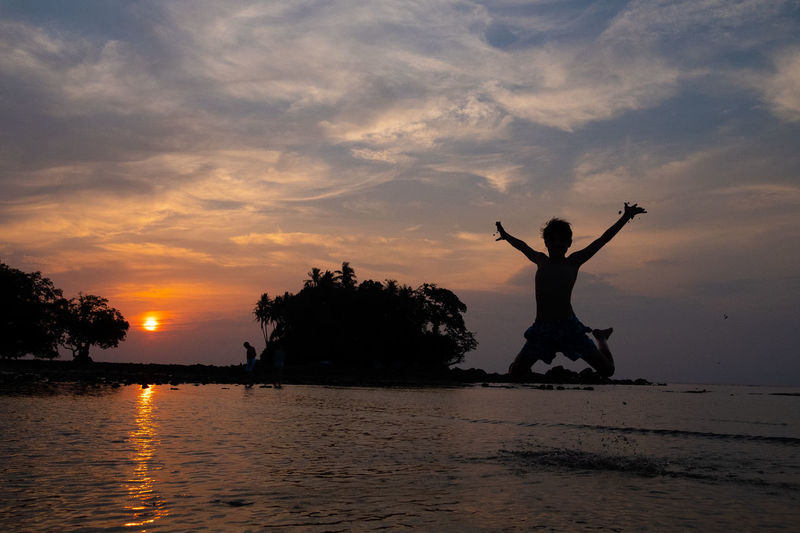awaking giant Phuket Thailand Arms Raised Beach Beauty In Nature Beutifulplace Cloud - Sky Freedom Jumping Kid Leisure Activity Lifestyles Nature One Person Outdoors Real People Scenics - Nature Sea Silhouette Sky Sunset Tranquil Scene Tranquility Water