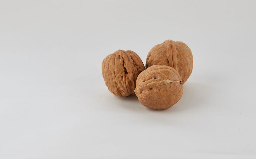 A group of walnut on the right side frame with grey background. Dried Fruit Food Groups Of Wal Nutshell Studio Shot Walnut Walnut Group Walnut Shell