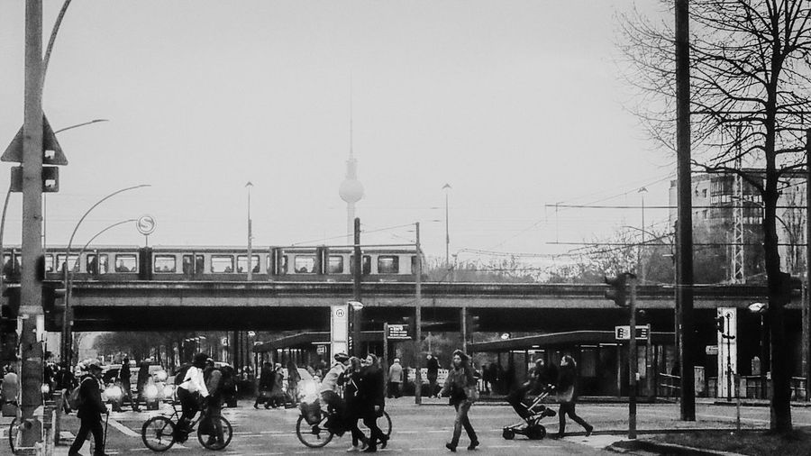 EyeEm Best Shots Berlin Group Of People Sky Architecture Crowd Built Structure Large Group Of People Transportation City Real People Nature Day Mode Of Transportation Women Men Building Exterior Connection Adult Outdoors