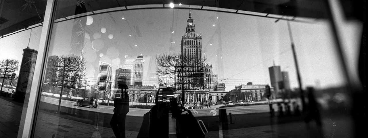 HORIZONT Panoramic The Art Of Street Photography Horizont Panoramic Film Photography Analogue Photography Street Photography The Week on EyeEm Capture The Moment Bnw Black And White Monochrome Panoramic Film Rollei Wide Architecture City Building Exterior Built Structure Real People Building City Life Adult People Walking Women Group Of People Men Street Transparent Glass - Material Lifestyles Office Building Exterior Modern Skyscraper Outdoors Cityscape