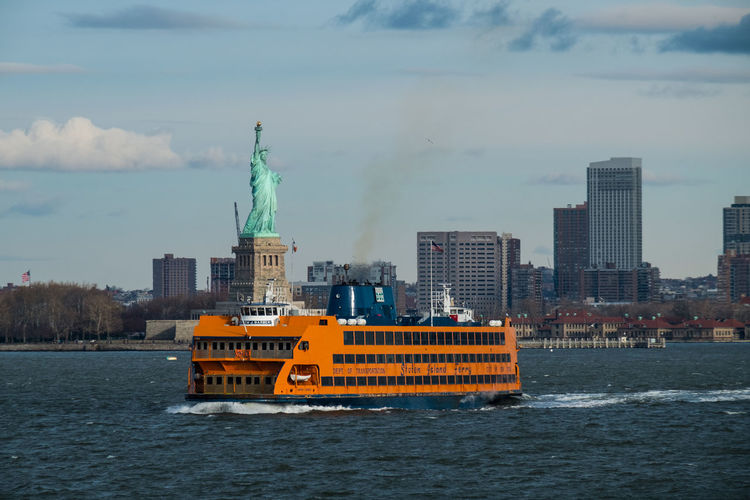 Staten Island Ferry and Statue of Liberty, New York, NY City Cityscape Cloud - Sky Manhattan Mode Of Transport New York No People Sky Staten Island Ferry Statue Of Liberty Tourism Travel Destinations Water