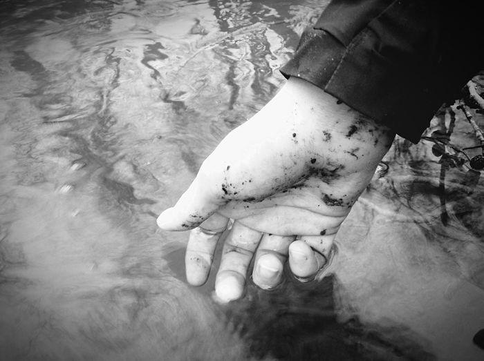 Muddy hand in the water. Muddy Hand Water Blackandwhite