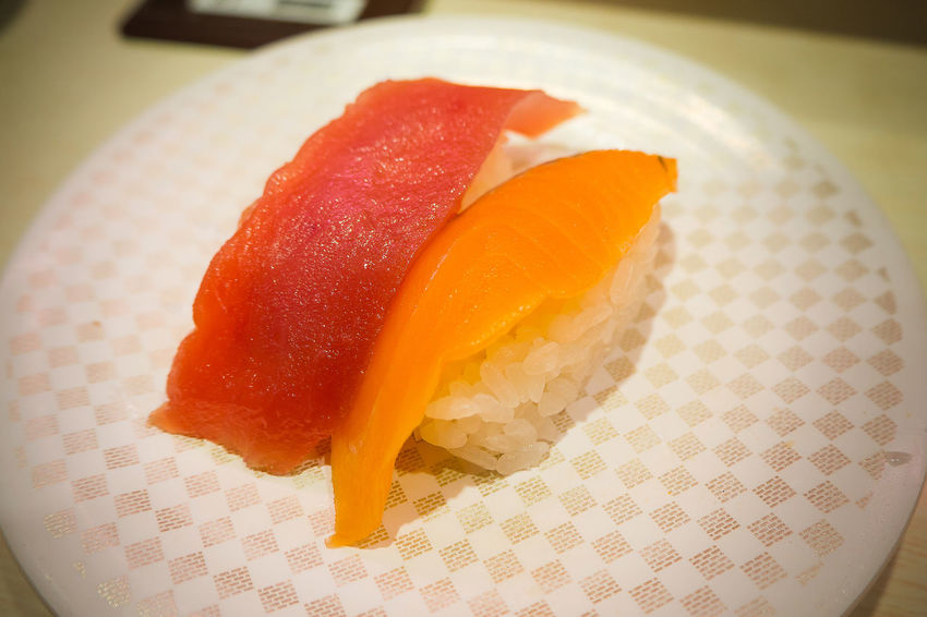 The sushi 100 yen on white Plate in Japanese restaurant in Tokyo 100yen Japan Japanese  Japanese Culture Close-up Day Food Food And Drink Freshness Indoors  Japannese Food No People Plate Ready-to-eat Suahi