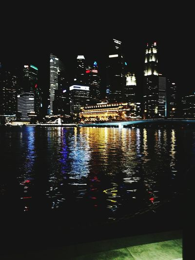Night Illuminated Reflection City Architecture Building Exterior Skyscraper Urban Skyline Cityscape Outdoors Modern Waterfront Travel Destinations Downtown District Water No People Sky Riverside Singapore Building Reflections Buildings Night Night City City Lights At Night