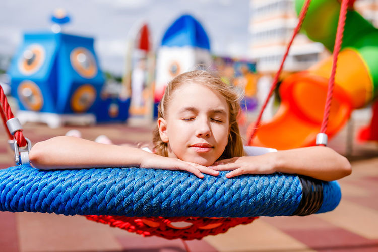 Portrait of girl relaxing outdoors
