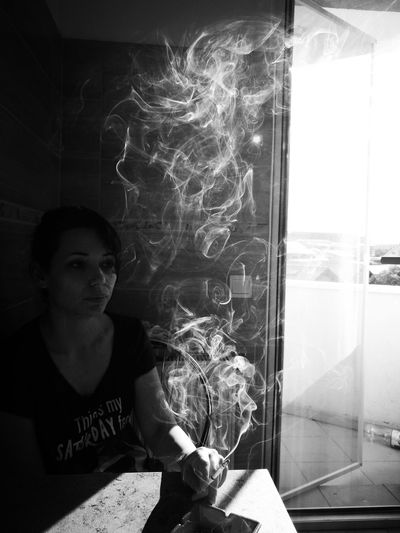 One women smoking Indoors  Window One Person Adult People Mature Adult Adults Only Home Interior Sitting Day Smoke Smoking Eyeem Smoking Eyeem Black And White EyeEm Selects EyeEmNewHere The Week On EyeEm Mix Yourself A Good Time
