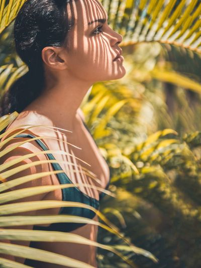 Tropical Paradise Beauty In Nature Contemplation Day Leisure Activity Lifestyles Nature One Person Outdoors Palmtree Plant Real People Sunlight Tropical Warm Feeling Warmth Woman In The Forest Young Women