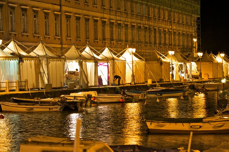 ponterosso's canal with stands at night during a festival At Night Landscape Ponterosso Ponterosso's Canal Sea Stands Trieste TriesteSocial Urban Landscape Street Photography Travel Pictures Summertime EyeEmNewHere Waterfrontview Neighborhood Map Colour Your Horizn