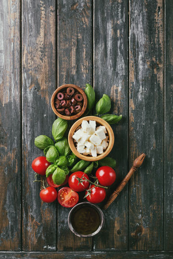 Traditional Greek Appetizer Feta with kalamata olives served with Greek Pita, tomatoes, basil and olive oil. Top View Olive Top View Bread Cheese Feta Food Food And Drink Fresh Greece Oil Pita Tomato