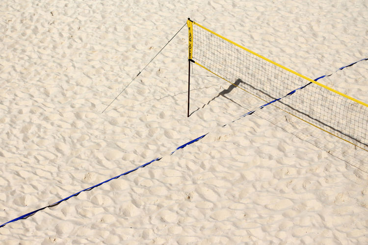 High angle view of net at beach during sunny day