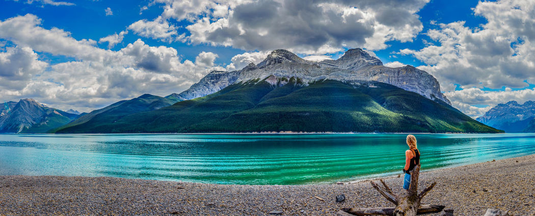Lake Minnewanka in Banff National Park Adult Banff National Park  Beauty In Nature Cloud - Sky Full Length Hiking Hikingadventures Lake Landscape Mountain Mountain Range Mountains Nature One Person Outdoors Panorama Panoramic Photography People Real People Scenics Sky Standing Tranquil Scene Water Women