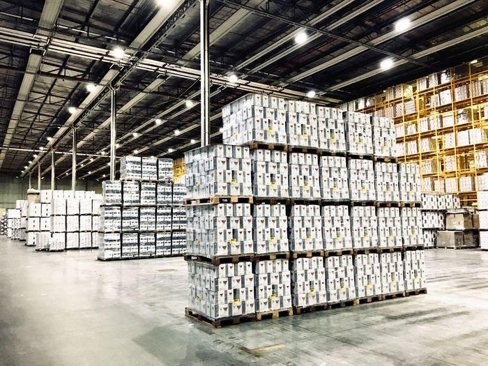 Shipping  Box Industry Urban Pile Stuff Economy Commercial Dock Pallet Stock Market Warehouse Architecture Indoors  Built Structure Building Large Group Of Objects Domestic Room Industry Stack Metal No People Abundance Arrangement Container Factory In A Row Distribution Warehouse Ceiling Box
