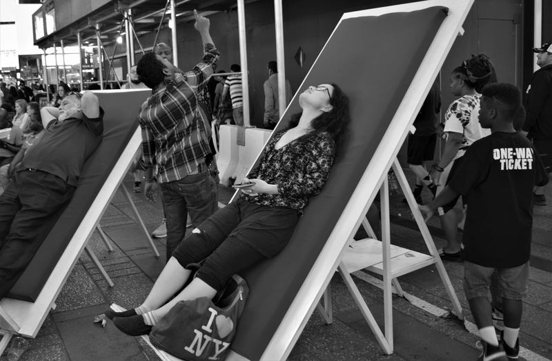 Moments from Manhattan Relaxing The Street Photographer - 2018 EyeEm Awards TimesSquare City Day Group Of People Laying Down Laying On An Angle Men One Way Ticket Pointing Pointing Up Real People Women