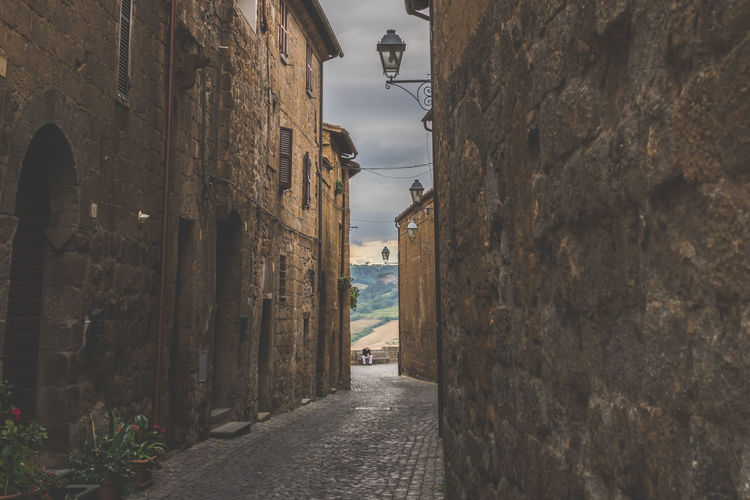 Street amidst buildings against sky in town