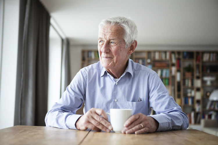Portrait of a man drinking coffee