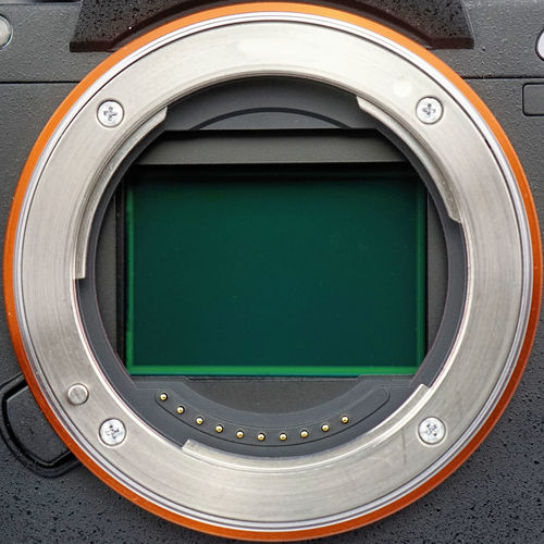 Lens ring of a full-size camera with open sensor plate, close-up image Camera Reflection Body Part Circuit Circuit Board Close-up Computer Day Equipment Green Color Indoors  Macro Microchip Mirrorless Mount No People Sensor Technology