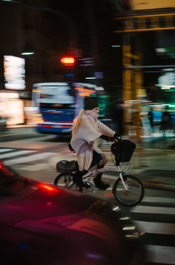 Haas Motion Capture Tomorrow Blurred Motion Transportation Mode Of Transportation Motion Land Vehicle City Riding Ride Speed Real People Street Architecture One Person Bicycle Men Full Length Road Night on the move Outdoors The Street Photographer - 2019 EyeEm Awards The Traveler - 2019 EyeEm Awards