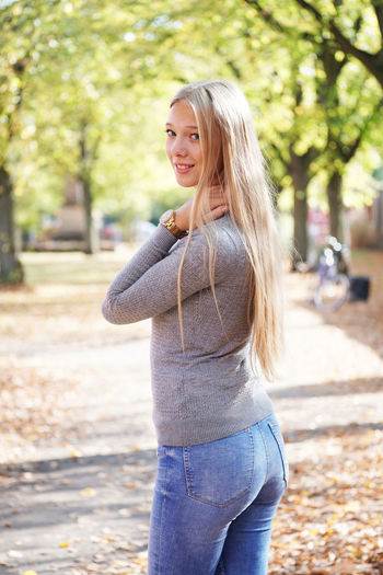 Blond Hair One Person Young Adult Beautiful Woman Portrait Girl Young Woman Women Teenager Teen Teenage Girls Real People People person Outdoors Outside Long Hair Casual Clothing Park Nature Day Sunny Sunny Day Spring Autumn Autumn Leaves Fall Walking Walk Standing Looking At Camera Jeans Turning