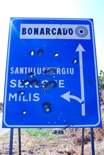 Sardinia Bonarcado Bullet Holes Welcome