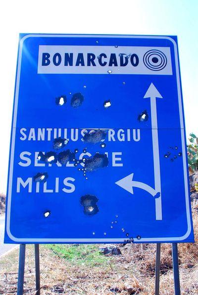 Sardinia Bonarcado Bullet Holes Welcome