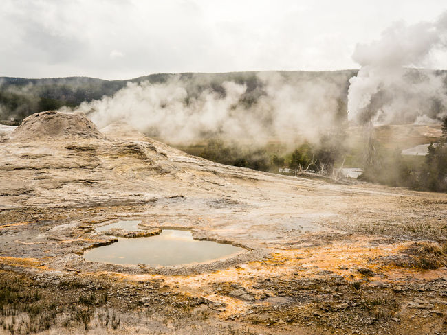 Beauty In Nature Day Hot Spring Landscape Nature No People Old Faithful Outdoors Scenics Sky Water