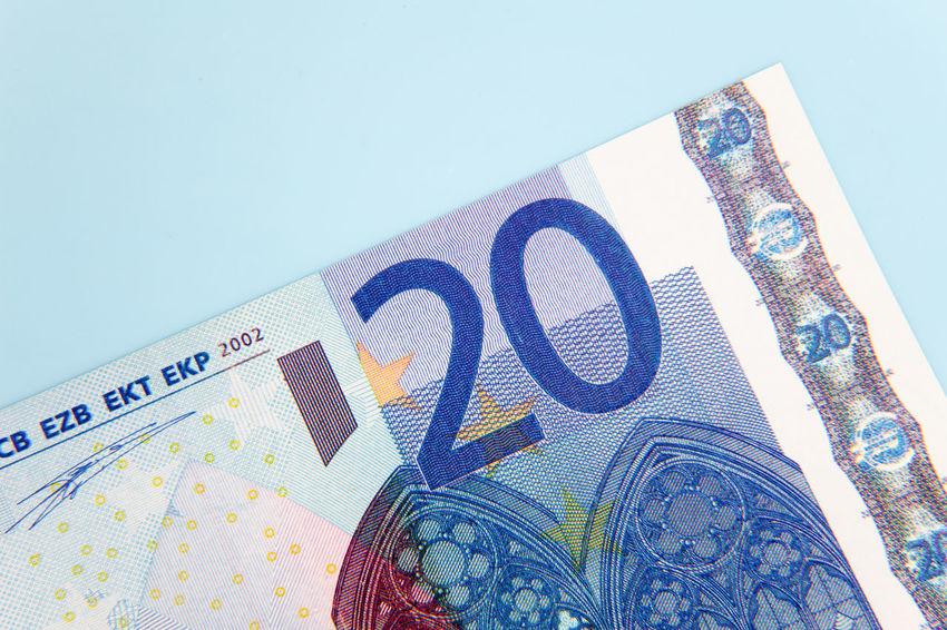 Twenty euro note on light blue background Banking Bonus Credit Currency Debit Euro Notes Euro Zone Financial Financial Planning Financial Service Make Money Money Money Money Money Premium Save Money Savings