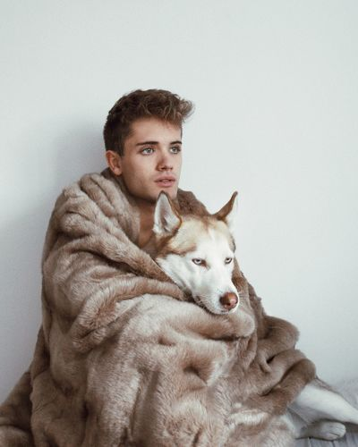 Winter is here EyeEm Nature Lover EyeEm Best Shots Wolf Portrait Photography Portrait Looking At Camera Young Adult Portrait Young Men One Person Animal Themes Pets One Animal Real People Studio Shot Indoors  Lifestyles