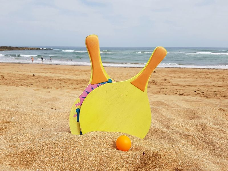 Beach Sand Sea Water Horizon Over Water Yellow Sky Summer Cloud - Sky No People Outdoors Vacations Day Multi Colored Wave Sand Pail And Shovel Swimming Nature