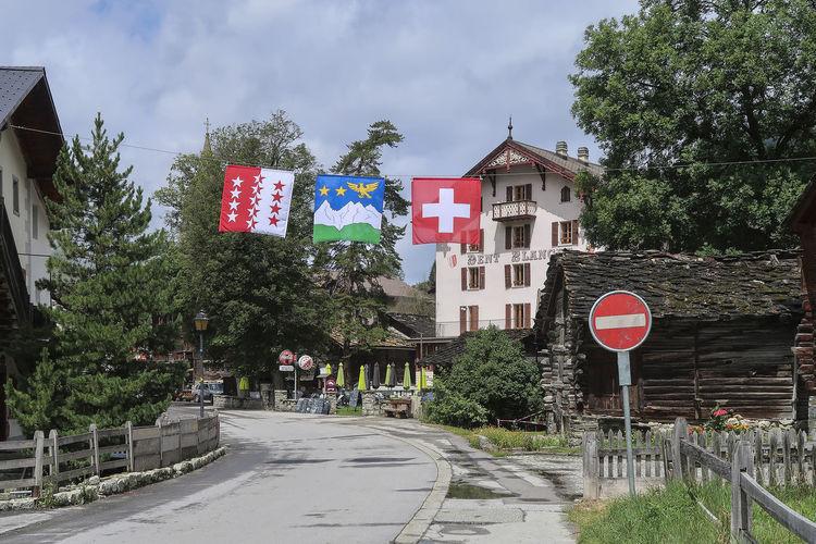 Evolene, Switzerland - July 24, 2017; Entrance of the village of Evolene in Valais, Switzerland a popular tourist alpine location Evolène Switzerland Village Valais, Switzerland Alpine Street Tourism Destination Town