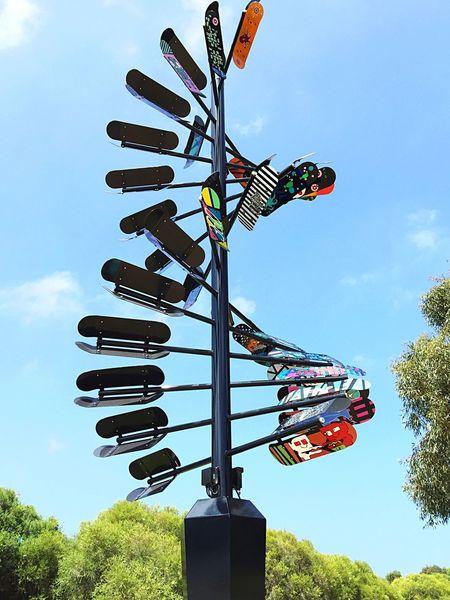 Skateboards: Moving Solar Sculpture Skateboards Sculpture Solar Environmental Sculpture Moving Sculpture Spiral Spiral Sculpture Art Three Dimensional Skateboard Sculpture Skateboard Art Colorful Spinning Around Spinning Sculpture Rotating ArtWork Expression Artistic Expression Skatepark Sculpture Western Australia