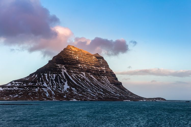 The golden side Iceland Kirkjufell Seascape Sea Mountain Snow Water Beach Cold Temperature Sunset Natural Phenomenon Power In Nature Blue Volcanic Landscape Erupting Volcanic Rock Geyser Geology Frozen Water Natural Landmark Physical Geography