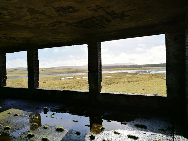 Window Frame Ruined Building Window View Landscape Outdoors Ruins Sky Cloud - Sky Nature Water No People Scenics Agriculture Day