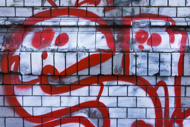 Cartoonish graffiti on brick wall in Berlin, Germany Architecture Backgrounds Berlin Brick Wall Cartoonish Close-up Color Image Day Full Frame Funny Germany Graffiti Horizontal No People Outdoors Photography Red Red Text Wall - Building Feature White Color