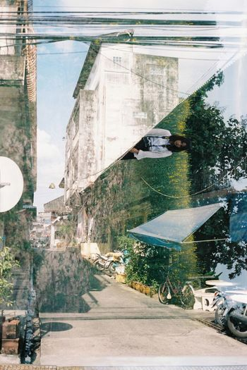 EyeEmNewHere Reflection Outdoors Water Road No People Tree Nature Architecture Lighting Social Issues Lifestyles Filmisnotdead Filmphotographer Doubleexposure Analog Life In Motion Architecture Creativity Inthemoment Multi-layered Effect City Building Exterior Natural Light Eyemphotography