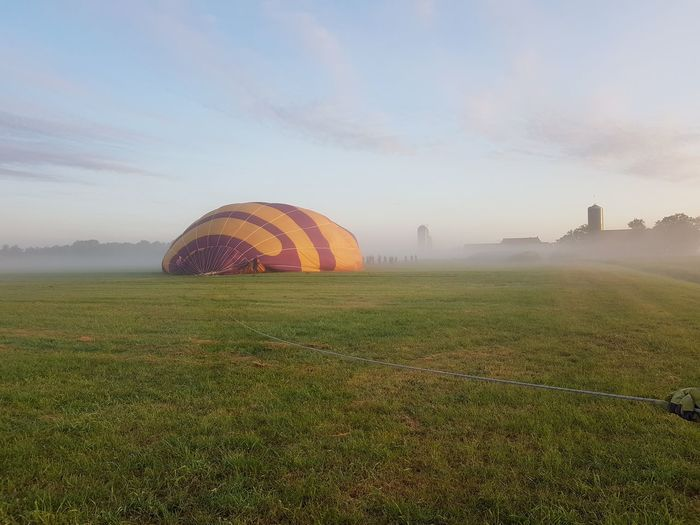 make the airballoon ready to fly AirBalloon EyeEm Selects Agriculture Sunset Rural Scene Field Crop  Shadow Red Sky Foggy