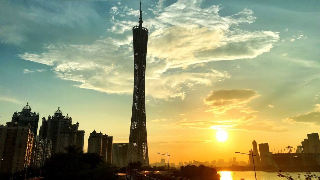 A short glimpse from afar... EyeEm Best Shots China Cityscape Clouds And Sky Pearl River Architecture Built Structure Buildings & Sky Travel Destinations Travel Travel Photography Guangzhou Canton Tower Sky Architecture Built Structure Building Exterior Sunset City Cloud - Sky Silhouette Tower